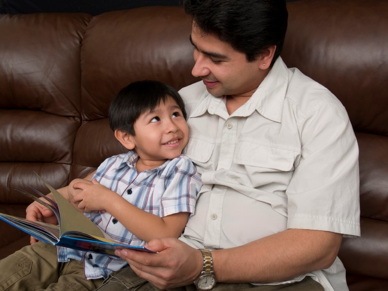hispanic dad read to son (Custom)