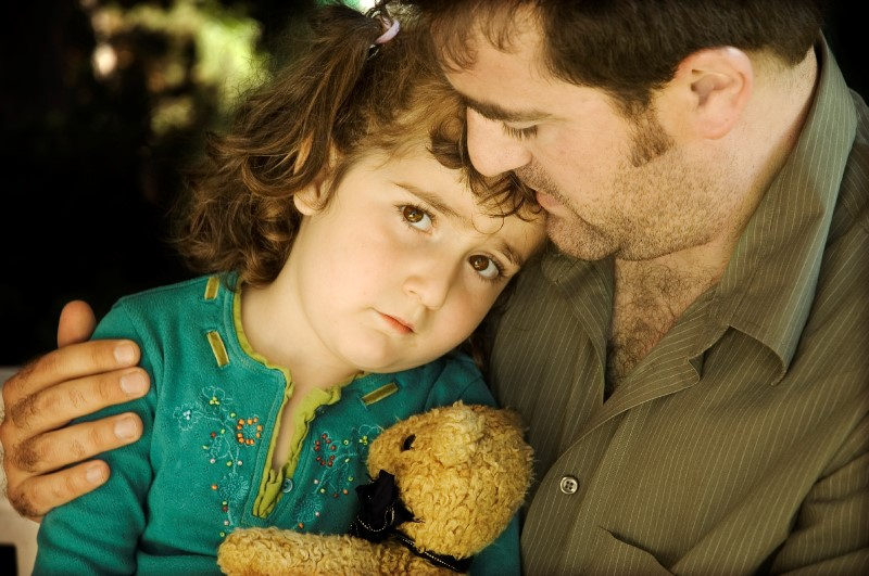 iStock_sad girl and dad (Custom)