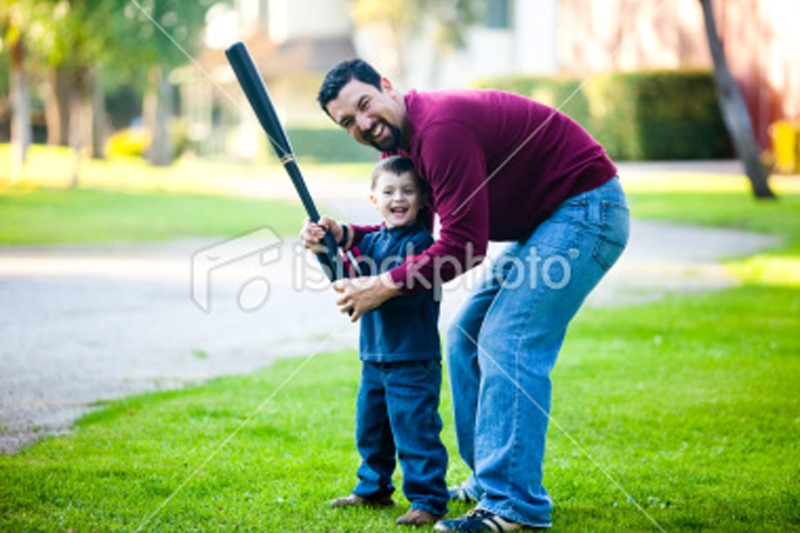 ist2_11237172-father-and-son-playing-ball (Custom)